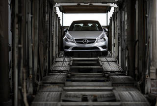 A Mercedes-Benz vehicle sits inside a car-carrier before being hauled away for distribution from the company's Vehicle Processing Center in Baltimore. AP Photo Patrick Semansky - AP