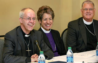 "The Most Rev. Justin Welby, the archbishop of Canterbury, left, speaks during a news conference at the ""Reclaiming the Gospel of Peace"" conference Thursday at the Reed Conference Center in Midwest City. With Welby, spiritual leader of the worldwide Anglican Communion, is the Most Rev. Katharine Jefferts Schori, middle, presiding bishop of the Episcopal Church USA, and the Rt. Rev. Edward Konieczny, right, bishop of the Episcopal Diocese of Oklahoma. Photo by Jim Beckel, The Oklahoman Jim Beckel -"