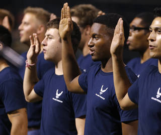 Donald Anderson and other Air Force recruits are sworn in between innings during the Devon Energy Hometown Heroes Celebration Night at the Chickasaw Bricktown Ballpark in Oklahoma City, Saturday, August 9, 2014. Photo by Bryan Terry, The Oklahoman