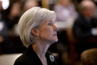 Department of Health and Human Services Secretary Kathleen Sebelius listens from the audience before announcing easier access to mental health care during Former First Lady Rosalynn Carter's 29th annual mental health policy symposium at the Carter Center on Friday, Nov. 8, 2013, in Atlanta. (AP Photo/David Tulis)
