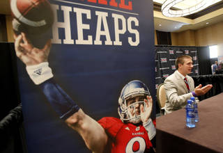 Kanas quarterback Jake Heaps conducts interviews during a breakout session at the Big 12 Conference Football Media Days Monday, July 22, 2013 in Dallas. (AP Photo/Tim Sharp) ORG XMIT: TXTS126