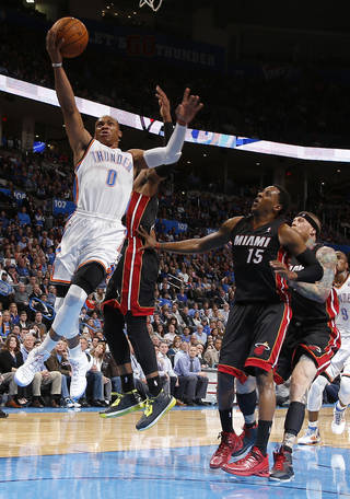 Oklahoma City's Russell Westbrook (0) goes to the basket past Miami's Mario Chalmers (15) during an NBA basketball game between the Oklahoma City Thunder and the Miami Heat at Chesapeake Energy Arena in Oklahoma City, Thursday, Feb. 20, 2014. Oklahoma CIty lost 103-81. Photo by Bryan Terry, The Oklahoman