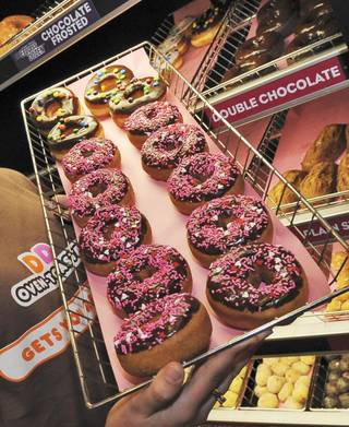 ADDS - DUNKIN' DONUTS BEGAN ELIMINATING TRANS FATS YEARS AGO - FILE - In this Feb. 12, 2008 file photo, a rack of donuts is displayed at a Dunkin' Donuts franchise in Boston. Consumers wondering what food without trans fat will taste like, probably already know as food manufacturers, including Dunkin' Donuts, began eliminating it years ago. (AP Photo/Lisa Poole, File)