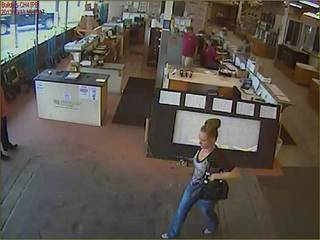 The woman wanted for questioning is show walking around the store where the fraudulent check was used. PHoto courtesy of the Oklahoma City Police Department