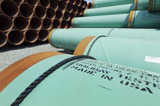 Some of about 500 miles worth of coated steel pipe manufactured by Welspun Pipes Inc., originally for the Keystone oil pipeline, are stored in Little Rock, Ark. AP File Photo Danny Johnston - AP