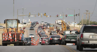 A water line construction project is slowing traffic on Hefner Road just east of Hefner Parkway. Photo By David McDaniel, The Oklahoman