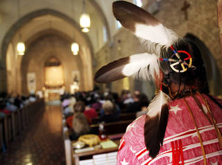 Albert GrayEagle stands at the back of the Abbey Church at St. Gregory's Abbey during Mass on July 14, 2013 for the celebration of a feast day for Saint Kateri Tekakwitha in Shawnee. Tekakwitha is the first native American canonized by the Roman Catholic church in October 2012. Photo by KT KING, The Oklahoman
