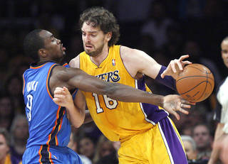Left: Oklahoma City's Serge Ibaka, left, defends against Los Angeles' Pau Gasol during Game 4 on Saturday. Photo by Nate Billings, The Oklahoman