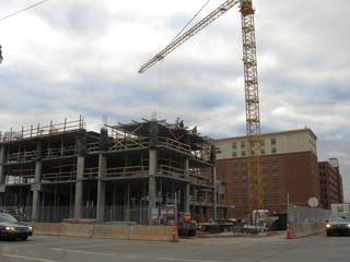 Construction continues Friday on the 11-story Hilton Garden Inn/Homeward Suites at 328 E Sheridan Ave. The hotel is one of two being built in or around Bricktown, with five others to be built over the next two years. - STEVE LACKMEYER