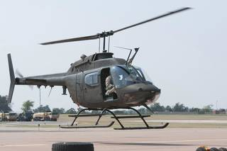 A Bell OH-58 Kiowa helicopter hovers at the Muldrow Army Heliport in Lexington during a flight demonstration. Photo provided Spc. Elijah Morlett