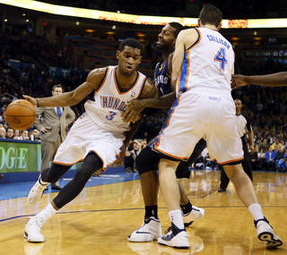 Oklahoma City's Perry Jones (3) dribbles around a Nick Collison (4) screen of Memphis' James Johnson (3) in the second half during an NBA basketball game between the Oklahoma City Thunder and the Memphis Grizzlies at Chesapeake Energy Arena in Oklahoma City, Monday, Feb. 3, 2014. Oklahoma City won, 86-77. PHOTO BY NATE BILLINGS, The Oklahoman