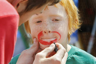 Elias Gates, 7, gets his face painted at the Center for Children and Families' annual I Love My Neighborhood block party at Trinity Baptist Church on Saturday, April 9, 2011, in Norman, Okla. Photo by Steve Sisney, The Oklahoman