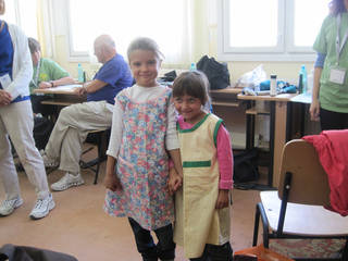 Two girls wear dresses made by Faye Flowers. Photo provided by Feed The Children.