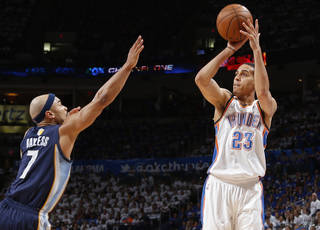NBA BASKETBALL: Oklahoma City's Kevin Martin shoots the ball over Memphis' Jerryd Bayless during Game 2 in the second round of the NBA playoffs between the Oklahoma City Thunder and the Memphis Grizzlies at Chesapeake Energy Arena In Oklahoma City, Tuesday, May 7, 2013. Photo by Bryan Terry, The Oklahoman