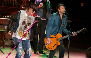 Axl Rose and Tommy Stinson of Guns N' Roses perform at the Bridge School Benefit Concert at the Shoreline Amphitheatre on Saturday, Oct. 20, 2012, in Mountain View, Calif. (Photo by Barry Brecheisen/Invision/AP) ORG XMIT: NYET411