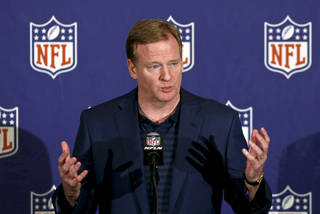 "FILE - In this March 20, 2013 file photo, NFL Commissioner Roger Goodell answers a reporter's question during a news conference during the annual NFL football meetings in Phoenix. The NFL has ordered all teams to have cameras in their locker rooms next season, with video shown only on stadium scoreboards. It's part of Goodell's initiative for ""enhancing the fan experience in our stadiums.: (AP Photo/Ross D. Franklin, File) ORG XMIT: NYKR501"