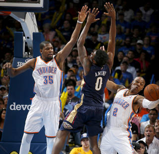 Oklahoma City's Kevin Durant (35) and Caron Butler (2) defend New Orleans' Al-Farouq Aminu (0) during an NBA basketball game between the Oklahoma City Thunder and the New Orleans Pelicans at Chesapeake Energy Arena in Oklahoma City, Friday, April 11, 2014. Photo by Bryan Terry, The Oklahoman