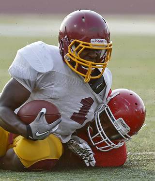 Putnam City North's Tae Moore is brought down by Lawton's BJ Scott during a high school football scrimmage at Putnam City High School in Warr Acres, Okla., Thursday, August 16, 2012. Photo by Bryan Terry, The Oklahoman