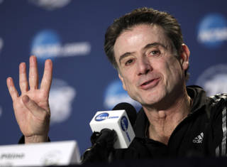 Louisville head coach Rick Pitino talks to reporters during a news conference, Saturday, March 30, 2013, in Indianapolis. Louisville is scheduled to play Duke in the Midwest Regional final in the NCAA college basketball tournament on Sunday. (AP Photo/Kiichiro Sato) ORG XMIT: NAS115