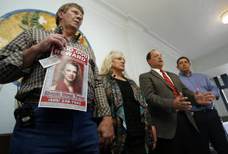 Joe and Donna Turner and Garvin County Sheriff Larry Rhodes announce that the family is offering a $100,000 reward for leads in the case of the death of the Turner's daughter Chanda on Wednesday, Dec. 5, 2012 in Pauls Valley, Okla. At far right is under sheriff Jim Mullett. Garvin County Sheriff's office has opened a homicide investigation after the medical examiners office changed the death certificate of the young woman killed over a decade ago in Pauls Valley. Photo by Steve Sisney, The Oklahoman STEVE SISNEY - THE OKLAHOMAN
