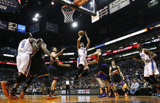 Oklahoma City Thunder's Thabo Sefolosha (2), of Switzerland, shoots as he gets past Phoenix Suns' Luis Scola, third from left, of Argentina, and Marcin Gortat, third from right, of Poland, while Thunder's Kendrick Perkins (5) and Kevin Durant (35) watch along with Suns' Goran Dragic (1), of Slovenia, during the first half in an NBA basketball game, Sunday, Feb. 10, 2013, in Phoenix. (AP Photo/Ross D. Franklin) ORG XMIT: PNU108