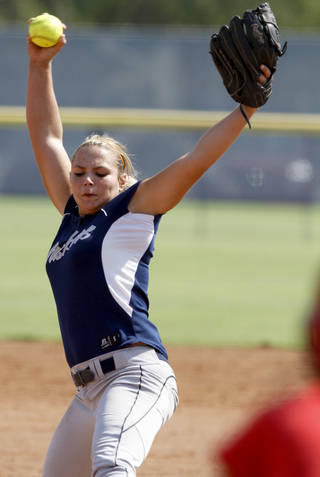 Edmond North's Jordan Dixon pitches against Grove during a high school softball game at ASA Hall of Fame Stadium in Oklahoma City, Saturday, August 27, 2011. Photo by Bryan Terry, The Oklahoman