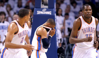 Oklahoma City's Russell Westbrook (0) reacts after taking fall during game five of the Western Conference semifinals between the Memphis Grizzlies and the Oklahoma City Thunder in the NBA basketball playoffs at Oklahoma City Arena in Oklahoma City, Wednesday, May 11, 2011. Photo by Sarah Phipps, The Oklahoman