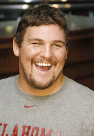 Oklahoma's Tyler Evans laughs as he answers a question during an interview in Norman, Okla., Tuesday, Oct. 25, 2011. After a loss on Saturday, the Sooners are left to focus on the Big 12 title and hope for the best in the BCS chase. (AP Photo/Sue Ogrocki) ORG XMIT: OKSO105