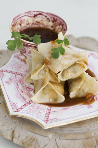 In this image taken on January 14, 2013, vegetarian steamed dumplings with sweet-and-sour sauce are shown served on a plate in Concord, N.H. (AP Photo/Matthew Mead) ORG XMIT: NYLS668