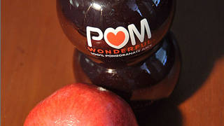 (FILES)In this October 19, 2010 file photo illustration a bottle of POM Wonderful pomegranate juice is shown next to a pomegranate. The U.S. Supreme Court on April 21, 2014 heard an appeal by Pomegranate-juice maker POM Wonderful LLC, which alleges that Coca-Cola Co. deceived consumers about the contents of a juice offered by the latters Minute Maid unit. POM says the Minute Maid label is misleading because the product contains little actual pomegranate or blueberry juice, while Coca-Cola says the label accurately informed consumers that the juice tastes like pomegranate and blueberry. AFP PHOTO/Karen BLEIERKAREN BLEIER/AFP/Getty Images ** OUTS - ELSENT, FPG - OUTS * NM, PH, VA if sourced by CT, LA or MoD **