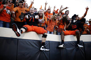 Oklahoma State's Parker Graham (71) celebrates with fans during the second half of a college football game between the Oklahoma State University Cowboys (OSU) and the Kansas State University Wildcats (KSU) at Boone Pickens Stadium in Stillwater, Okla., Saturday, Oct. 5, 2013. OSU won 33-29.Photo by Sarah Phipps, The Oklahoman