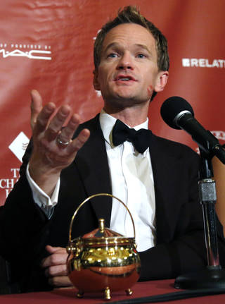 Actor Neil Patrick Harris speaks during a news conference after his roast as Man of The Year by Harvard University's Hasty Pudding Theatricals in Cambridge, Mass., Friday, Feb. 7, 2014. (AP Photo/Elise Amendola)