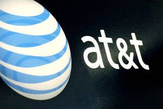 The AT&T logo is on display at a RadioShack store in Gloucester, Mass. AP Photo
