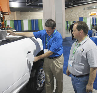 Mike Zielinsky, regional account executive at Chrysler, shows a natural gas-powered Ram 2500 at the Shale Gas Insight 2012 conference Friday in Philadelphia. PHOTO BY ADAM WILMOTH, THE OKLAHOMAN