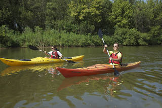 Oklahoma City University students Kelsey Dolphin and Jack Malone enjoy a day of kayaking in the Stinchcomb Wildlife Refuge in Oklahoma City. Photo provided by Georgia Read