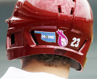 Oklahoma's Kolbey Carpenter wears a sticker to honor the victims of the May 20 tornado during the Big 12 Tournament. Photo by Bryan Terry, The Oklahoman