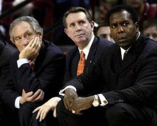 In this Jan. 24, 2005, file photo, then-Oklahoma State coach Eddie Sutton, left, and then-assistants James Dickey and Jimmy Williams, right, watch from the bench during an NCAA college basketball game against Oklahoma in Norman, Okla. Williams, who sued Minnesota coach Tubby Smith over an aborted hiring, was awarded nearly $1.25 million by a jury Wednesday, May 26, 2010. The jury found that Smith falsely represented that he had the authority to hire Williams when he called Williams in 2007 to talk about an assistant coach position in Minnesota. (AP Photo/Sue Ogrocki, File)