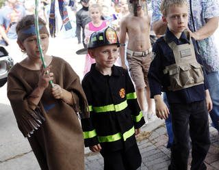 Madelyn Barman, 9, left, Grayson Barman, 5, and Wesley Barman, 6, walk in the children's parade at the Bethany 66 Festival. Photo by K.T. King, The Oklahoman KT King -