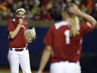OU's Kelsey Stevens reacts afterr giving up a run in the second inning of of a Women's College World Series game between at ASA Hall of Fame Stadium in Oklahoma City Thursday, May 29, 2014. Photo by Bryan Terry, The Oklahoman