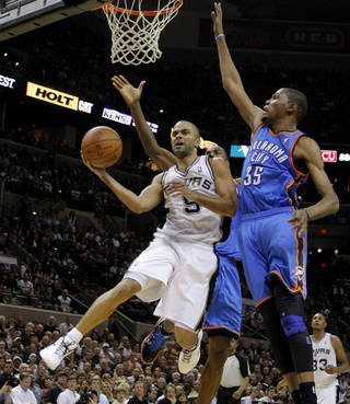 San Antonio's Tony Parker (9) goes past Oklahoma City's Kevin Durant (35) during Game 2 of the Western Conference Finals between the Oklahoma City Thunder and the San Antonio Spurs in the NBA playoffs at the AT&T Center in San Antonio, Texas, Tuesday, May 29, 2012. Oklahoma City lost 120-111. Photo by Bryan Terry, The Oklahoman