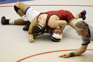 Tuttle's Seth Shelton (red) and Vinita's Alex Kauffman (white) wrestle in the 160 pound match at the 4A West Regional wrestling championship in Harrah on Saturday, Feb. 22, 2014. Tuttle's Seth Shelton defeated Vinita's Alex Kauffman with a pin to advance to state. Photo by KT King, The Oklahoman