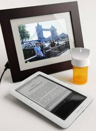 A pill bottle that reminds consumers when to take their medicine, Nook electronic reader and a digital picture display that can accept e-mailed images are among the new devices that connect to AT&T's wireless network. Photo by Doug Hoke