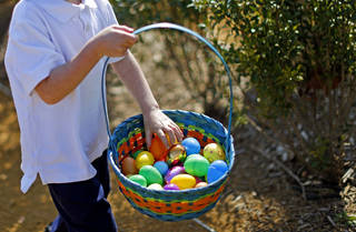 A child gathers eggs during the Myriad Gardens Annual Easter Egg Hunt in downtown Oklahoma City, Saturday, March 30, 2013. Photo by Bryan Terry, The Oklahoman
