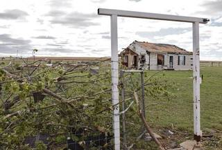 A small farm house still stands after being hit by Tuesday's tornado west of El Reno, Wednesday, May 25, 2011. Photo by Chris Landsberger, The Oklahoman ORG XMIT: KOD