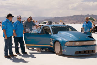 Brent Hajek, left and E85 Mustang crew members perform final checks at the starting line at Bonneville Salt Flats, Utah, just before the car's 252 mph run. PHOTO PROVIDED BY PATRICK QUIRK