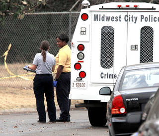 Midwest City Police investigators take photos at the scene of a police involved shooting near Lions Park Place and Midwest Blvd. in Midwest City, OK, Monday, December 3, 2012, By Paul Hellstern, The Oklahoman