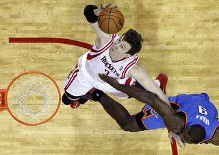 Houston's Omer Asik (3) shoots over Oklahoma City's Serge Ibaka (9) during Game 6 in the first round of the NBA playoffs between the Oklahoma City Thunder and the Houston Rockets at the Toyota Center in Houston, Texas, Friday, May 3, 2013. Photo by Bryan Terry, The Oklahoman