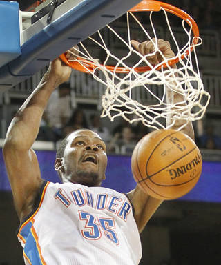 Oklahoma City's Kevin Durant dunks the ball against the Dallas Mavericks in the second period during their preseason NBA basketball game at Intrust bank Arena in Wichita, Kan,Wednesday Oct. 24, 2012. (AP Photo/The Wichita Eagle, Fernando Salazar) ORG XMIT: KSWIE105
