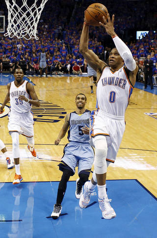 Oklahoma City's Russell Westbrook (0) takes the ball to the hoop on a fast break in front of Memphis' Courtney Lee (5) as Oklahoma City's Kevin Durant (35) looks on during Game 7 in the first round of the NBA playoffs between the Oklahoma City Thunder and the Memphis Grizzlies at Chesapeake Energy Arena in Oklahoma City, Saturday, May 3, 2014. The Thunder won 120-109. Photo by Nate Billings, The Oklahoman