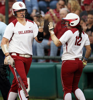 OU's Keilani Ricketts (10) is greeted by Callie Parsons after Ricketts scored in the 1st inning during an NCAA softball game between OU and Marist in the Oklahoma Regional in Norman, Okla., Friday, May 17, 2013. Oklahoma won 17-0 in 5 innings. Photo by Nate Billings, The Oklahoman